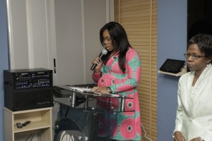 ONE OF THE GRADUATES READING OUT THE PROFILE OF KEYNOTE SPEAKER, PROF SIMI ODEYINKA OF OAU